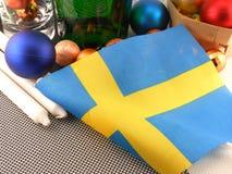 De vlag van Zweden met Kerstmisdecoratie, nieuw jaar Stock Fotografie