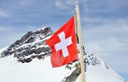 De vlag van Zwitserland op Jungfrau-berg Royalty-vrije Stock Foto's