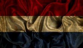 De vlagachtergrond van Grungenederland Stock Fotografie