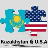 De vlaggen van de V.S. en van Kazachstan in raadsel Royalty-vrije Stock Foto