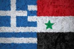 De vlaggen van Griekenland en van Syrië Stock Fotografie