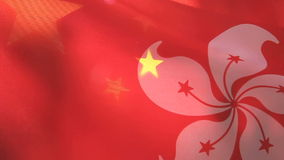 De vlaggen van Hong Kong en van China stock footage