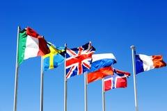 De vlaggen van zes landen Stock Fotografie