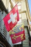 De Vlaggen van Zwitser en van Genève Stock Foto