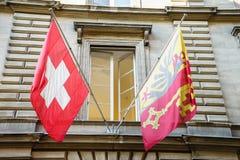 De Vlaggen van Zwitser en van Genève Royalty-vrije Stock Foto's