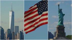 De Vlagstandbeeld van de V.S. van Liberty And NYC stock afbeeldingen