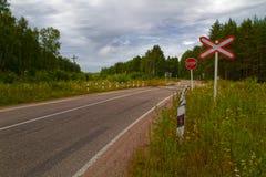 De vlakke kruising van de spoorweg Stock Foto's