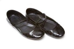 De vlakke misstap van dames op schoenen Royalty-vrije Stock Foto's