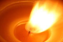 De vlam van de kaars Stock Foto's