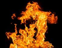 De vlammen van de brand op een zwarte achtergrond Royalty-vrije Stock Afbeeldingen