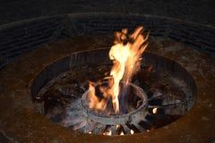 De vlammen van eeuwige brand Stock Foto