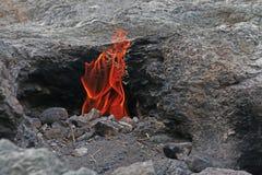 De vlammende rots Yanartas zet Hersenschim op Antalya, Turkije Stock Afbeeldingen