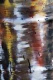 De vlekken van de olie op de ijzerflank Stock Afbeelding