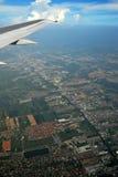 De vleugel van de aarde en van het vliegtuig Stock Foto