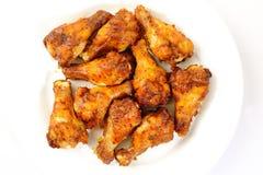 De vleugels van de kip op plaat Stock Foto