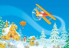De vliegen van de Kerstman in zijn vliegtuig Stock Fotografie
