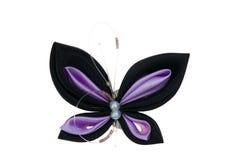 De vlinder van het stuk speelgoed die van linten wordt gemaakt Royalty-vrije Stock Afbeeldingen