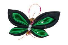 De vlinder van het stuk speelgoed die van linten wordt gemaakt Stock Foto's