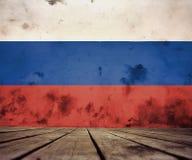 De vloer van planken en gepleisterde muur met Russische vlag royalty-vrije illustratie