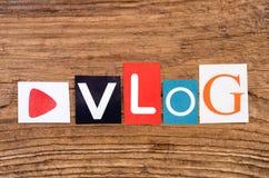 ` De Vlog de ` de Word sur le fond en bois Photo libre de droits