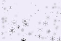 De vlokken van de Bokehsneeuw en witte achtergrond Royalty-vrije Stock Foto's