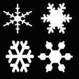 De vlokken van de sneeuw op zwarte achtergrond Royalty-vrije Stock Foto