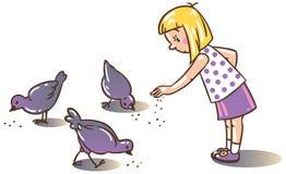 De voedende duiven van het meisje Royalty-vrije Stock Foto