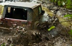 De voertuigen van het terrein het rennen stock foto's