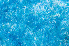 De voet veegt Blauwe wol af stock fotografie
