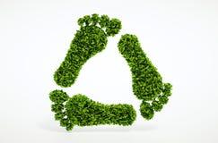 De voetafdruk van het ecologieblad recyclingssymbool Stock Foto's