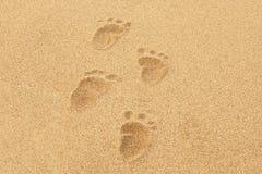 De Voetafdrukken van de baby in het zand Royalty-vrije Stock Fotografie