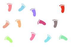 De voetafdrukken van kleurrijke kinderen Stock Afbeeldingen