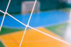 De voetbal defocused poortgebied, Futsal-balgebied in de gymnastiek binnen, het gebied van de Voetbalsport Stock Afbeelding