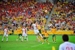 De Voetbal Team Cross Into The Bax van China Stock Afbeelding