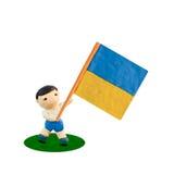 De Voetbal van het kind met de vlag Stock Afbeeldingen