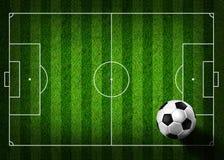 De voetbal van het voetbal op grasgebied Royalty-vrije Stock Afbeelding