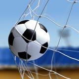 De voetbalbal is netto in doel royalty-vrije stock afbeeldingen
