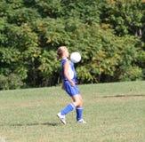 De Voetballer van het Meisje van de tiener in Actie 3 Stock Foto's