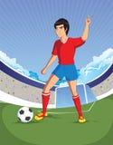 De voetbalvoetballer is aantal één op een stadionachtergrond Stock Afbeelding