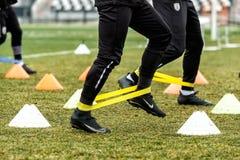 De voeten PAOKspelers en voetbal opleidingsmateriaal Royalty-vrije Stock Afbeeldingen