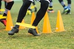 De voeten PAOKspelers en voetbal opleidingsmateriaal stock foto's