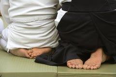 De voeten van de Aikidovechter op de mat Stock Fotografie