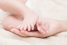 De voeten van de baby Stock Afbeeldingen