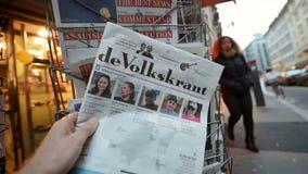 De Volkskrant Donald Trump new USA president. PARIS, FRANCE - NOV 10, 2016: Man buying Dutch newspaper with De Volkskrant shocking headline title at press kiosk stock video