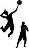 De volleyballspelers silhouetteren Stock Foto