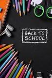 De volta à escola, artigos de papelaria no quadro-negro Imagem de Stock Royalty Free