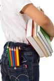 De volta à escola - caçoe com livros e lápis Fotografia de Stock