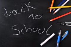 De volta ao conceito da escola escrito em um quadro-negro Imagens de Stock Royalty Free