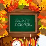 De volta ao fundo da escola com quadro do quadro-negro, do despertador, dos lápis, do bloco de notas e das folhas de outono na su Fotografia de Stock Royalty Free