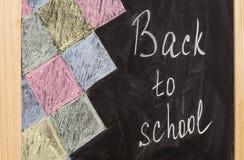 De volta ao giz da escola em um quadro-negro Imagens de Stock